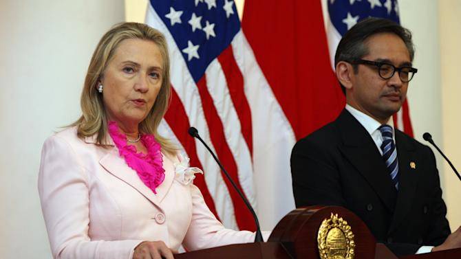 US Secretary of State Hillary Rodham Clinton, left, talks to the media as Indonesian Foreign Minister Marty Natalegawa listens during a press conference after their meeting in Jakarta, Indonesia, Monday, Sept. 3, 2012. (AP Photo/Dita Alangkara)