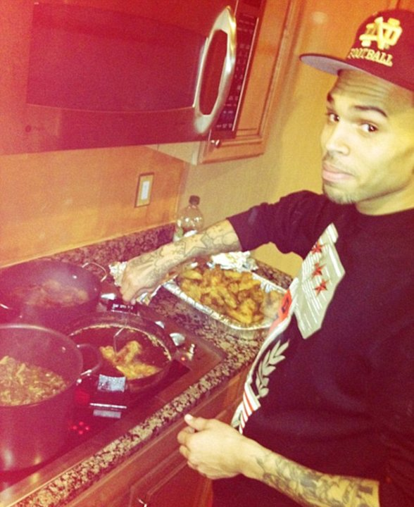 Celebrity photos: Who'd have thought that Chris Brown would be such a pro in the kitchen? He cooked dinner for his girlfriend and seemed to do a rather good job.