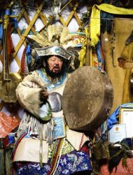"Mongolian shaman Zorigtbaata, a cast member in the documentary ""Mongolian Bling"" by Australian Benj Binks, plays a drum at an undisclosed location, in this picture provided by ""Mongolian Bling"" and dated December 10, 2009. REUTERS/Benj Binks/Mongolian Bling/Handout"