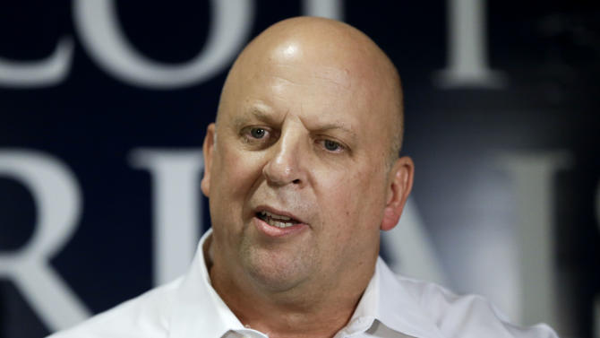 Rep. Scott DesJarlais, R-Tenn., speaks to supporters after he was declared the winner of Tennessee's 4th Congressional District Republican primary race Thursday, Aug. 7, 2014, in South Pittsburg, Tenn. (AP Photo/Mark Humphrey)