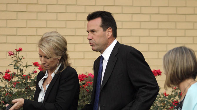 Houston Texans head coach Gary Kubiak and his wife, Rhonda, left, arrive at the funeral for former Tennesee Titans NFL football offensive coordinator Mike Heimerdinger on Friday, Oct. 14, 2011, in Nashville, Tenn. Heimerdinger died of a rare form of cancer on Sept. 30, 2011. (AP Photo/Mark Humphrey)