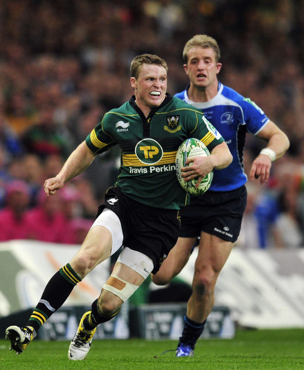 Northampton Saints' English winger Chris Ashton runs with the ball during the Heineken Cup Final match against Leinster at the Millennium Stadium in Cardiff on May 21, 2011.  AFP PHOTO/GLYN KIRK NOT F