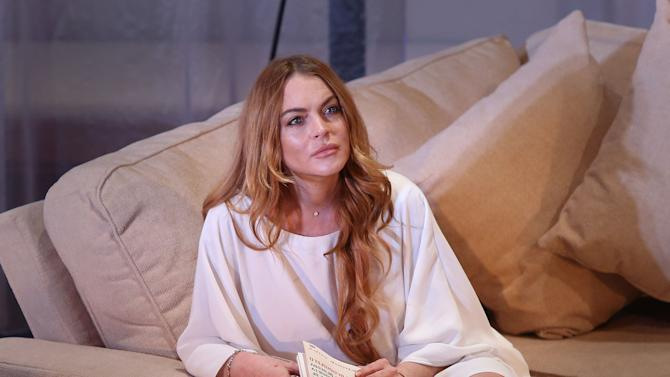 "FILE - In this Tuesday, Sept. 30, 2014 file photo, U.S actress Lindsay Lohan performs a scene from the play, ""Speed the Plow,"" during a photocall at the Playhouse Theatre in central London. A prosecutor said Wednesday, May, 27, 2015, that it appears  Lohan has completed the community service terms of her sentence in a 2012 reckless driving case. A judge will determine on Thursday, May 28, 2015, whether Lohan has completed her sentence, which would release her from probation in Los Angeles for the first time in nearly seven years. (Photo by Joel Ryan/Invision/AP, File)"