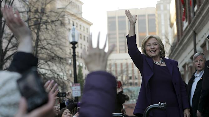 U.S. Democratic presidential candidate Hillary Clinton greets the crowd outside a campaign rally at Faneuil Hall in Boston