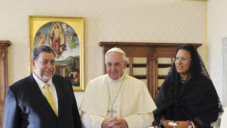 Pope Francis poses with Saint Vincent and the Grenadines' PM Gonsalves and his wife during a private audience at the Vatican