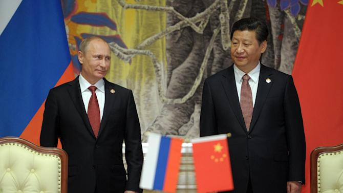 Russia's President Vladimir Putin, and China's President Xi Jinping, right, smile during signing ceremony in Shanghai, China on Wednesday, May 21, 2014. China signed a long-awaited, 30-year deal Wednesday to buy Russian natural gas worth some $400 billion in a financial and diplomatic boost to diplomatically isolated President Vladimir Putin. (AP Photo/RIA Novosti, Alexei Druzhinin, Presidential Press Service)