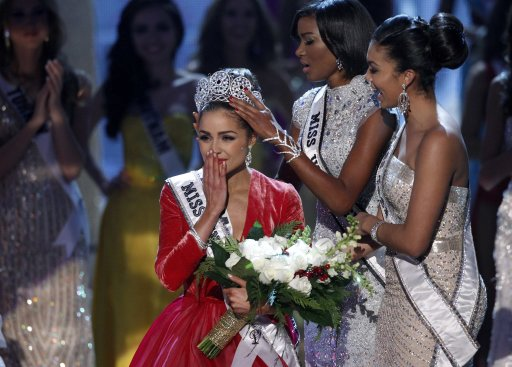 Miss USA Culpo reacts as she is crowned by Miss Universe 2011 Lopes during Miss Universe pageant in Las Vegas