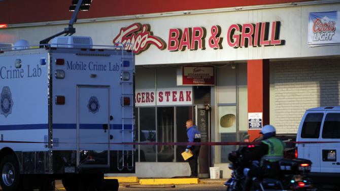 Police are pictured at Fero's Bar and Grill in Denver on Wednesday, Oct. 17, 2012, where the bodies of a man and four woman were discovered after firefighters extinguished a fire at the bar early Wednesday morning.(AP Photo/Ed Andrieski)