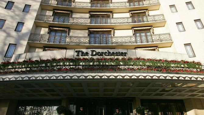 Doormen wait to assist residents at the entrance of The Dorchester Hotel in London. Located on Park Lane, in the heart of Mayfair, The Dorchester is one of London's top luxury hotels.