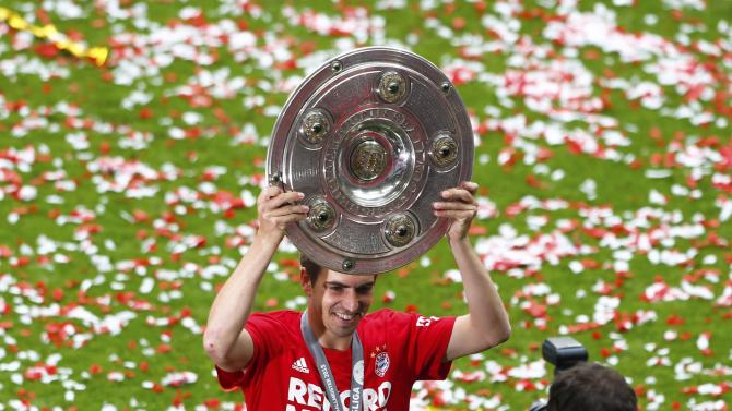 Bayern Munich's Lahm holds the trophy after their final German first division Bundesliga soccer match of the season against FSV Mainz 05 in Munich