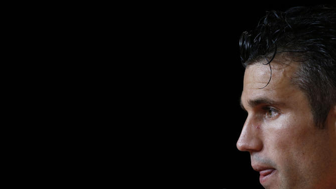 Robin van Persie of the Netherlands pauses before answering questions at a press conference after a training session in Rio de Janeiro, Brazil, Friday, June 20, 2014. The Netherlands play in group B of the 2014 soccer World Cup. (AP Photo/Wong Maye-E)