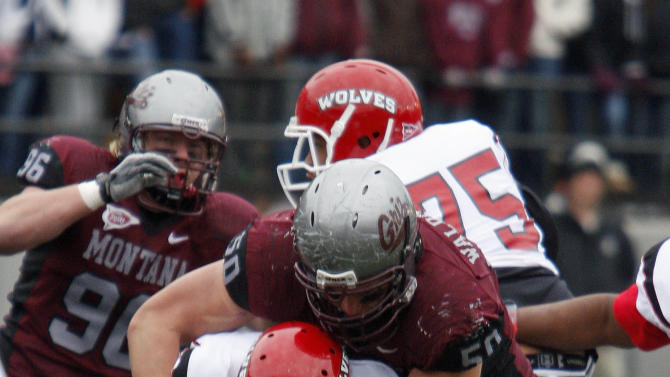 Western Oregon quarterback Cory Bean (12) is sacked by Montana defensive tackle Bryan Waldhauser (50) during the fourth quarter of an NCAA college football game in which Montana won 32-7 in Missoula, Mont., on Saturday, Nov. 5, 2011. (AP Photo/Michael Albans)
