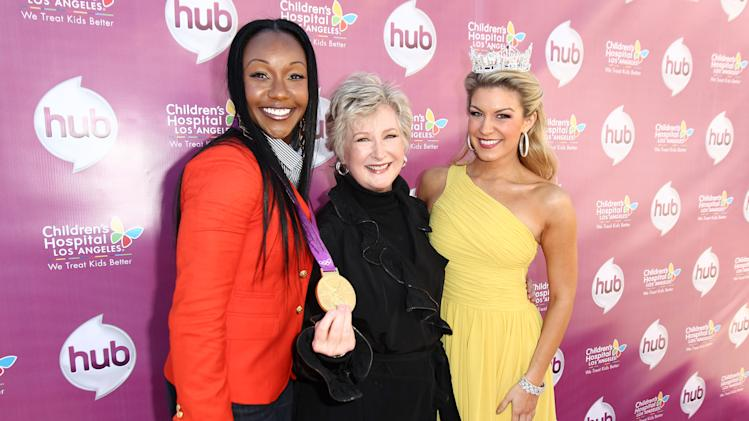 "IMAGE DISTRIBUTED FOR THE HUB - From left, Carmelita Jeter, Margaret Loesch, president and CEO of The Hub TV Network, and Miss America 2013 Mallory Hagan attend The Hub TV Network's ""My Little Pony Friendship is Magic"" Coronation Concert at the Brentwood Theatre on Saturday, Feb. 9, 2013, in Los Angeles in support of Children's Hospital LA. (Photo by Matt Sayles/Invision for The Hub/AP Images)"