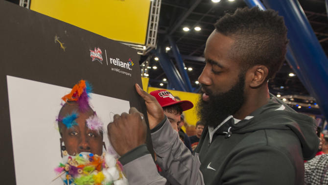 "IMAGE DISTRIBUTED FOR RELIANT - Houston Rockets guard James Harden signs the winner of the ""Build the Beard"" contest during the NBA All-Star Jam Session sponsored by Reliant, Saturday, Feb. 16, 2013, in Houston. (Dave Einsel/AP Images for Reliant)"