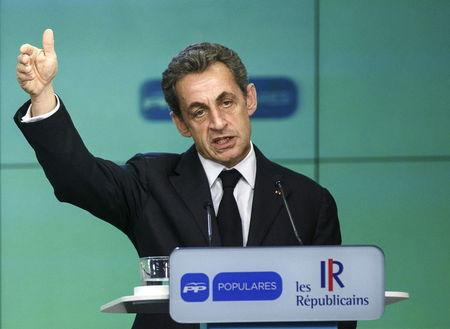France's former President and head of the conservative Les Republicains party Sarkozy gestures as he speaks during a news conference at the People's Party (PP) headquarters in Madrid