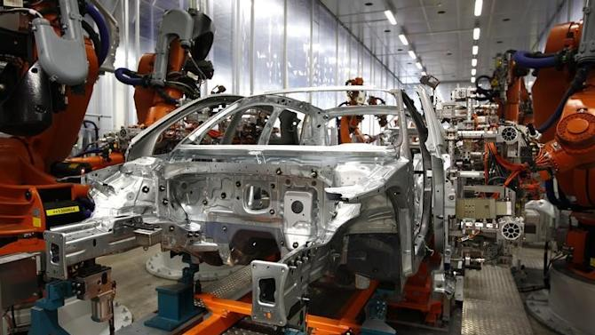 Robots connect side parts on Audi A3 light weight construction chassis at production line of German car manufacturer's plant in Ingolstadt