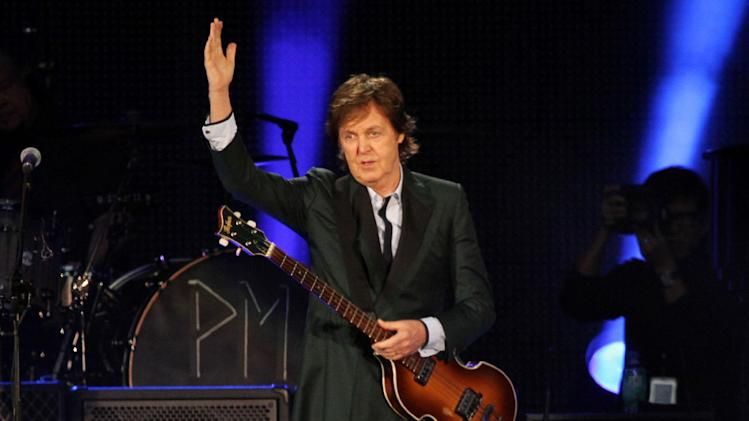 """FILE - This July 9, 2013 file photo shows Paul McCartney performing at Fenway Park in Boston, Mass. McCartney celebrated his 2-year wedding anniversary with his wife and few hundred students.The 71-year-old performed at the Frank Sinatra School of the Arts in the borough of Queens on Wednesday. McCartney said """"happy anniversary baby"""" to Nancy Shevell before going into his latest song, """"New."""" (Photo by Marc Andrew Deley/Invision/AP, File)"""