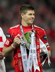 Liverpool's Steven Gerrard celebrates with the Carling Cup trophy last season