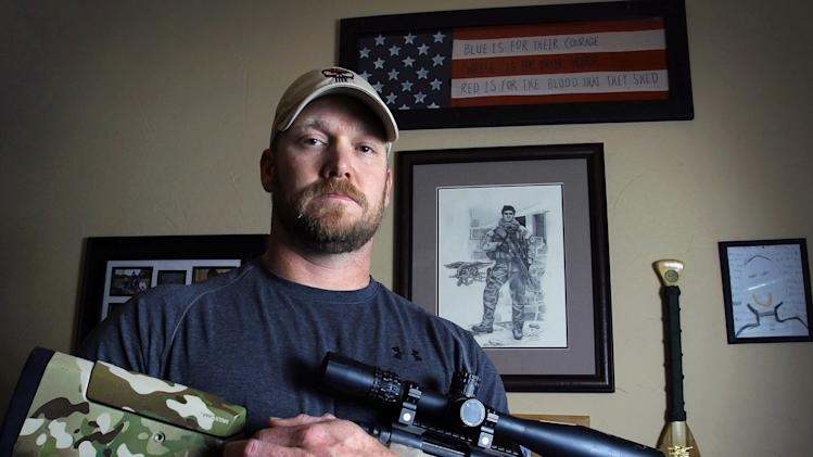 "In this April 6, 2012, photo, former Navy SEAL and author of the book ""American Sniper"", Chris Kyle poses in Midlothian, Texas. A Texas sheriff has told local newspapers that Kyle has been fatally shot along with another man on a gun range, Saturday, Feb. 2, 2013. (AP Photo/The Fort Worth Star-Telegram, Paul Moseley)"
