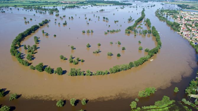 Copters pluck families from raging European floods
