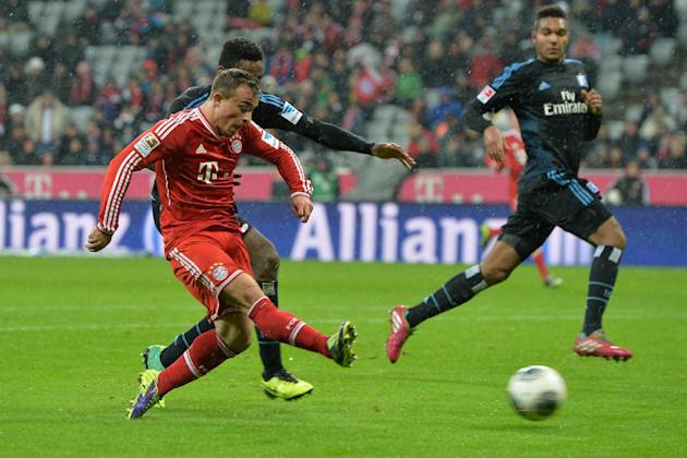 Bayern's Xherdan Shaqiri, left,  of Switzerland scores during  the German first division Bundesliga soccer match between FC Bayern Munich and Hamburger SV  in Munich, Germany, Saturday, Dec. 14, 2