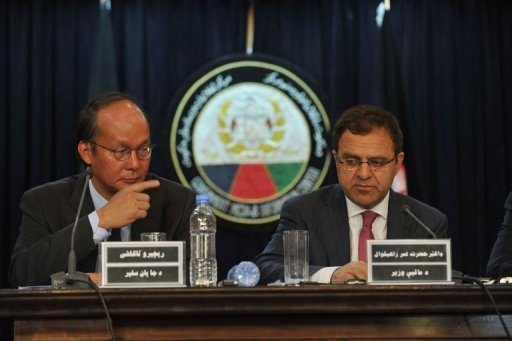 Afghan Finance Minister Hazrat Omar Zakhilwal (R) and Japan's Ambassador to Kabul, Reiichiro Takahashi