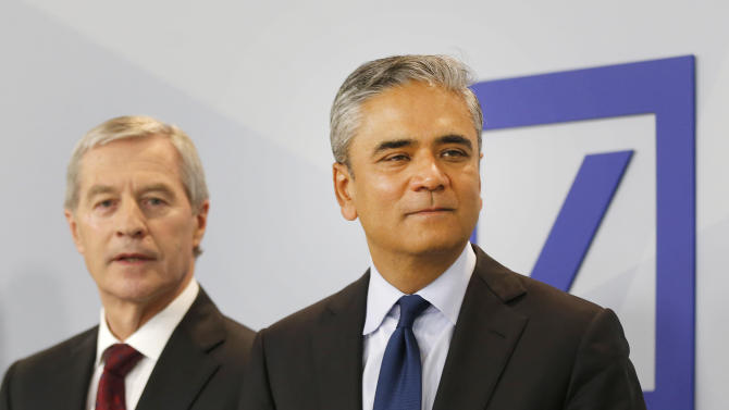 Co-CEOs of Deutsche Bank Anshu Jain, right, and Juergen Fitschen stand together prior to a press conference about the further strategies of the bank in Frankfurt, Germany, Monday, April 27, 2015. (AP Photo/Michael Probst)