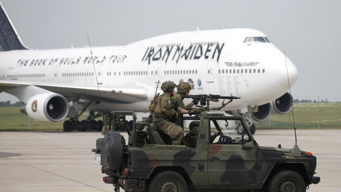 German armed forces Bundeswehr soldiers on their vehicle perform a rescue and evacuation operation in front of the Ed Force One, the aeroplane of British heavy metal band Iron Maiden at the ILA Berlin Air Show in Schoenefeld