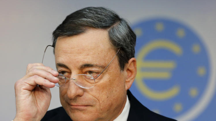 FILE - In this Thursday, Nov. 7, 2013, file photo, President of European Central Bank Mario Draghi adjusts his glasses during a news conference in Frankfurt, Germany, following a meeting of the ECB governing council. The possibility of large-scale bond purchases by the European Central Bank has been broached in recent days as policymakers grapple with alarmingly low inflation and a muted economic recovery from recession. (AP Photo/Michael Probst)