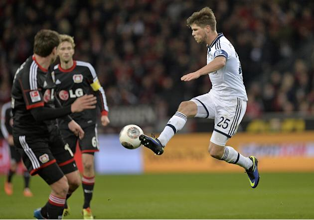 Schalke's Klaas-Jan Huntelaar of the Netherlands, right, jumps for the ball during  the German Bundesliga soccer match between Bayer Leverkusen and FC Schalke 04 in Leverkusen,  Germany, Saturday,