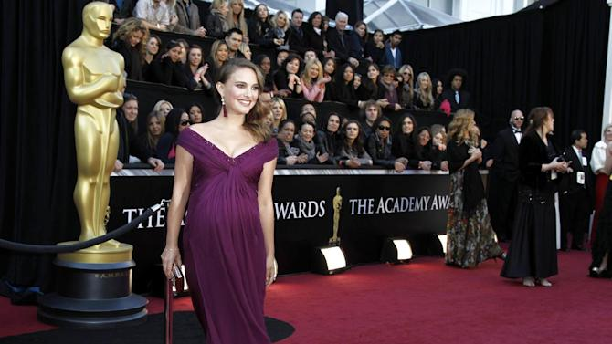 """FILE - In this Feb. 27, 2011 file photo, actress Natalie Portman, wearing an ensemble styled by Kate Young, arrives at the 83rd Academy Awards in the Hollywood section of Los Angeles. Young, the stylist responsible for some of Michelle Williams' and Natalie Portman's most memorable red carpet moments, tops The Hollywood Reporter's countdown of the 25 most powerful stylists in showbiz. Young earned the honor in part for helping make Portman a red carpet fixture last year while she was pregnant and on her way to winning the best actress Oscar for """"Black Swan."""" (AP Photo/Matt Sayles, file)"""