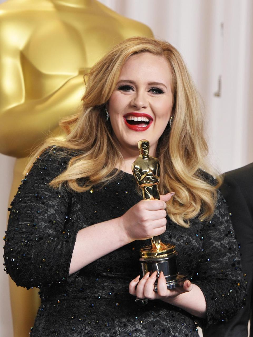 "Adele poses with her award for best original song for ""Skyfall"" during the Oscars at the Dolby Theatre on Sunday Feb. 24, 2013, in Los Angeles. (Photo by John Shearer/Invision/AP)"