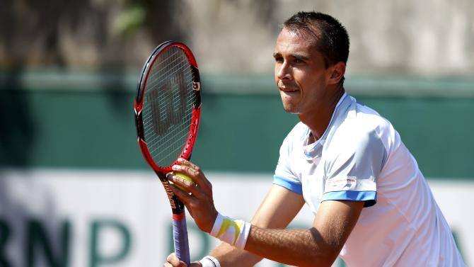 Lukas Rosol of the Czech Republic serves to Roberto Bautista Agut of Spain during their men's singles match at the French Open tennis tournament at the Roland Garros stadium in Paris