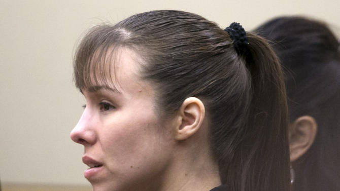 Jodi Arias stands as the jury enters the courtroom before the verdict for sentencing was declared a hung jury for her first degree murder conviction at Maricopa County Superior Court in Phoenix on Thursday, May 23, 2013. The jury in Jodi Arias' trial was dismissed Thursday after failing to reach a unanimous decision on whether the woman they convicted of murdering her one-time boyfriend should be sentenced to life or death in a case that has captured headlines worldwide with its sex, lies, violence. (AP Photo/The Arizona Republic, David Wallace, Pool)