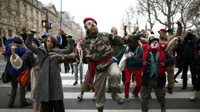 Environmentalists dance during a protest near the Place de la Republique after the cancellation of a planned climate march following shootings in the French capital, ahead of the World Climate Change Conference 2015 (COP21), in Paris