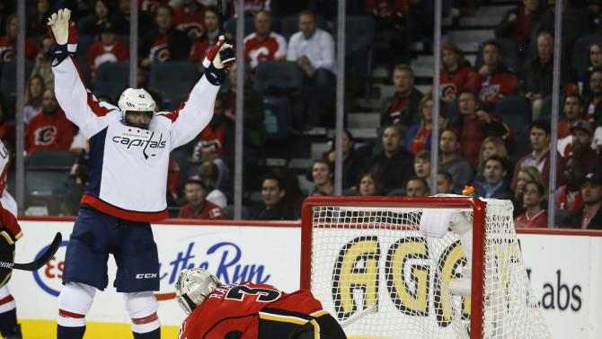 Ward scores 2, lifts Caps to 3-1 win over Flames