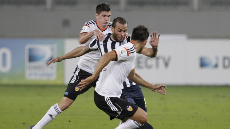 Rodrigo de Paul and Ruiz of Spain's Valencia CF fights for the ball with Guevgeozian of Peru's Alianza Lima during their Copa Euroamericana soccer match in Lima