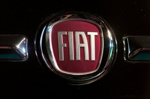 <p>A Fiat logo is displayed on a Fiat 500 car at an unveiling ceremony in Beijing in April 2012. Italy's Fiat Industrial will close five European plants of its truck subsidiary Iveco before year end to concentrate production at one German site.</p>