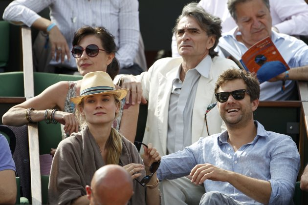Actors Diane Kruger, Joshua Jackson and singer Lio attend a match during the French Open tennis tournament at the Roland Garros stadium in Paris