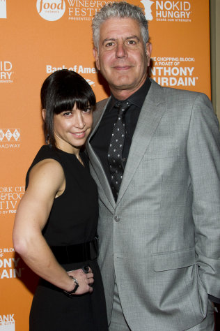 "Anthony Bourdain and Ottavia Busia attend ""On The Chopping Block: A Roast of Anthony Bourdain"" on Thursday, Oct. 11, 2012 in New York. (Photo by Charles Sykes/Invision/AP Images)"