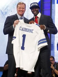 LSU cornerback Morris Claiborne, right, poses for photographs with NFL Commissioner Roger Goodell after being selected as the sixth pick overall by the Dallas Cowboys in the first round of the NFL football draft at Radio City Music Hall, Thursday, April 26, 2012, in New York. (AP Photo/Jason DeCrow)