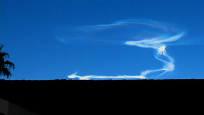 In this video frame grab provided by ABC15 in Phoenix, the contrail of a Juno ballistic missile fired from Fort Wingate near Gallup, N.M., reflects early morning sunlight high above New Mexico Thursday, Sept. 13, 2012. The twisting cloud-like formation, visible in Phoenix and Las Vegas just before sunrise, prompted hundreds of calls and emails to area television stations. The Juno missile, fired at 6:30 a.m. MDT, was then targeted by an advanced version of the Patriot missile fired from the U.S. Army's White Sands Missile Range. (AP Photo/ABC15)