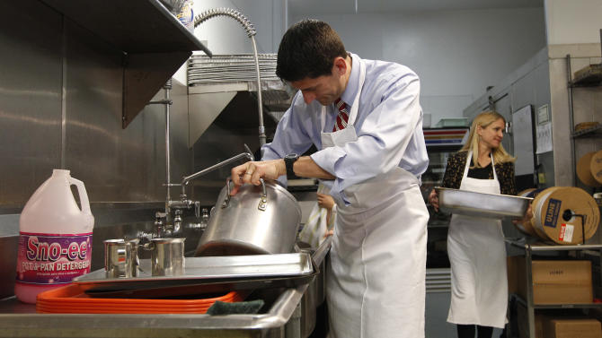 Republican vice presidential candidate, Rep. Paul Ryan, R-Wis., and his wife Janna wash pots at St. Vincent DePaul dinning hall, Saturday, Oct. 13, 2012, in Youngstown, Ohio.  (AP Photo/Mary Altaffer)