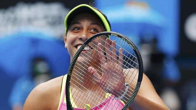 Keys of the U.S. celebrates defeating compatriot Venus to win their women's singles quarter-final match at the Australian Open 2015 tennis tournament in Melbourne
