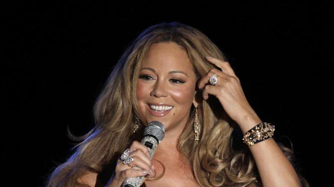 """FILE - This June 2, 2012 file photo shows American singer Mariah Carey performing during a concert in Monaco. Randy Jackson, Paula Abdul and Simon Cowell were the original judges on """"American Idol."""" The cast of judges has changed over the years, with Jackson now the lone judge left from the first season. On Sunday, Sept. 16, 2012, singer-rapper Nicki Minaj and country crooner Keith Urban were named as judges, joining Carey and Jackson, as the judges' panel has now expanded to four members from its previous three. (AP Photo/Lionel Cironneau, File)"""