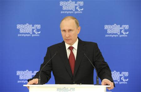 Russian President Vladimir Putin speaks during a meeting with paralympic delegations in Sochi