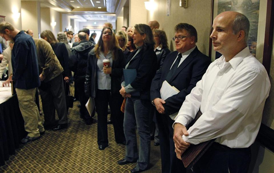 People wait in line to enter a job fair Friday, Dec. 2, 2011, in, Portland, Ore.  The unemployment rate fell last month to its lowest level in more than two and a half years, as employers stepped up hiring in response to the slowly improving economy. (AP Photo/Rick Bowmer)