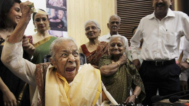 FILE – In this undated file photo, Indian actress and dancer Zohra Sehgal reacts as she cuts her birthday cake in New Delhi, India. Sehgal, who charmed viewers with her impish grin and twinkling eyes, has died of heart failure in New Delhi at age 102. (AP Photo/Press Trust of India) INDIA OUT