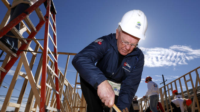 Former NFL head coach Joe Gibbs works with a hammer at the launch of M&M'S 'M' Prove America' campaign, which is designed to fund the construction of Habitat for Humanity homes across the country, on Friday, Feb. 1, 2013 in New Orleans. (Jonathan Bachman / AP Images for Habitat For Humanity)