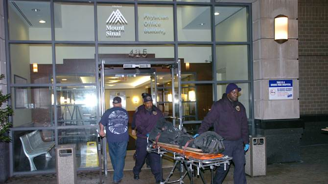 The body of Dmitriy Kanarikov, 35, is removed from 425 west 59th street, Sunday, Dec. 22, 2013, in New York. Authorities said they received an emergency call reporting two jumpers from the building around noon. Officers responding to the scene found Kanarikov, 35, of Brooklyn, and a 3-year-old boy on the lower rooftops of two separate nearby buildings. (AP Photo/David Torres)